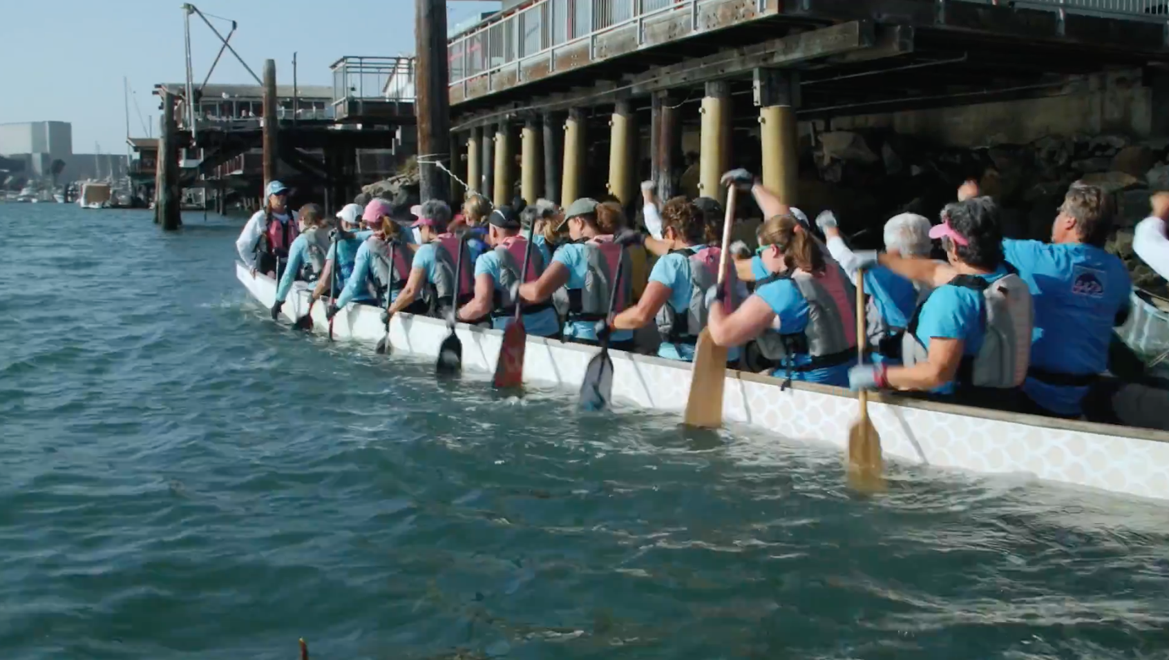 Team of women on a canoe with Hearst Research Fund