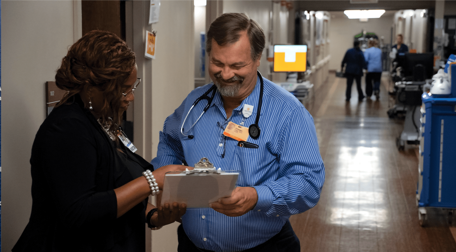Doctor and nurse looking at a clip board at French Hospital